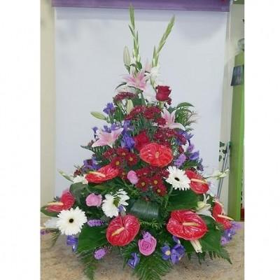 Centro de flor variada, según temporada