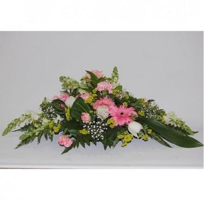 Centro apaisado de flor variada, según temporada