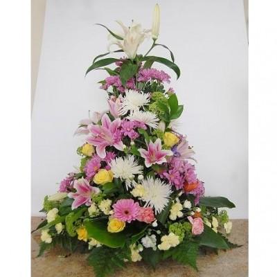 Centro de flor variada según temporada