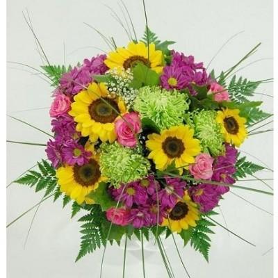 Ramo de flor variada, en tonos primaverales, según flor de temporada. (tonalidad del ramo: amarillo, rosa y verde)